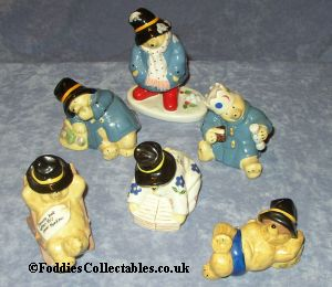 A Selection Of Coalport Paddington Bear Figurines
